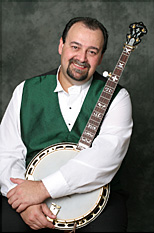 Steve Myers holding his custom banjo with Gold No Hole Dannick Tone Ring